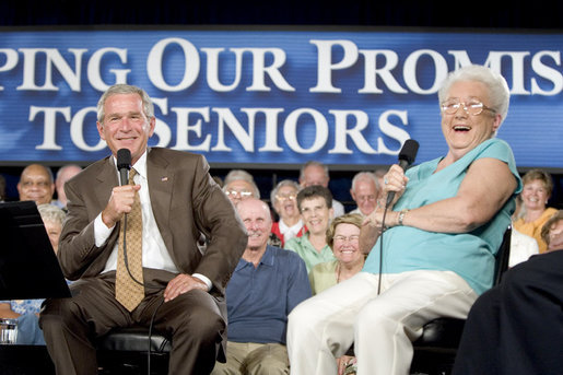 Bush laughing with senior citizen